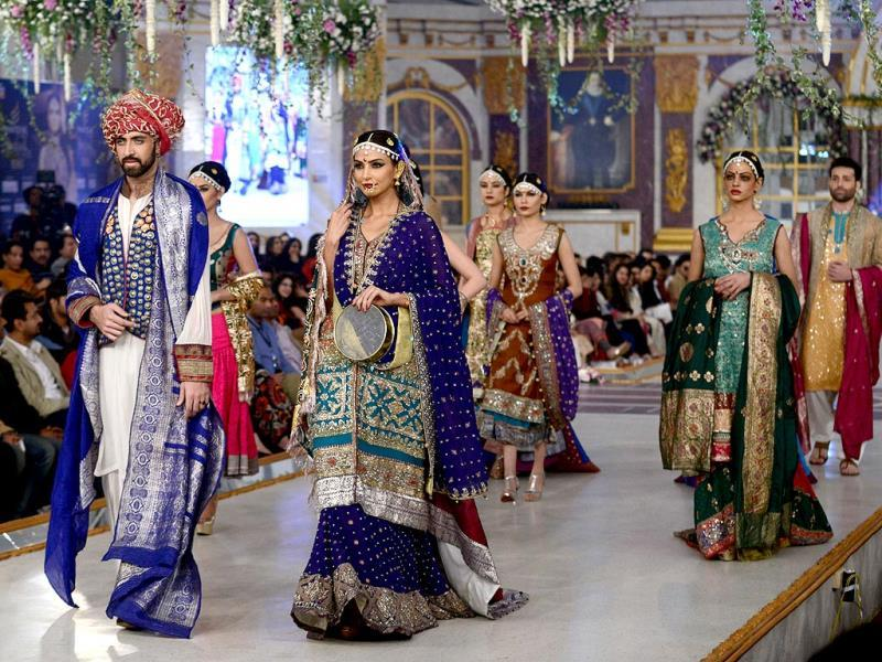 Models present creations by designer Zahid Khan. (AFP Photo)