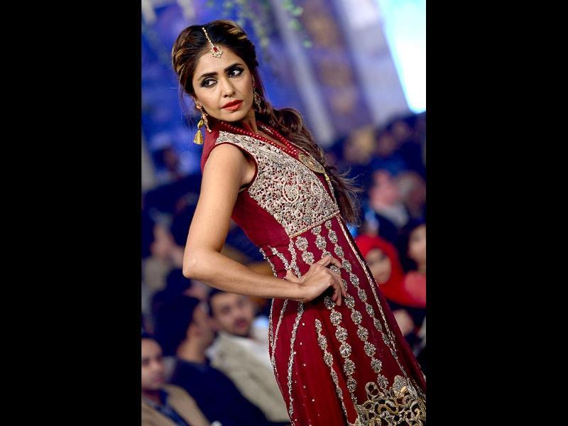 Model showcases a creation by designer Rani Emaan Khan. (AFP Photo)