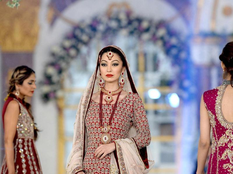 A Pakistani model presents a creation by designer Aisha Imran on the last day of the Pantene Bridal Couture Week 2013 in Lahore on late December 1, 2013. (AFP Photo)