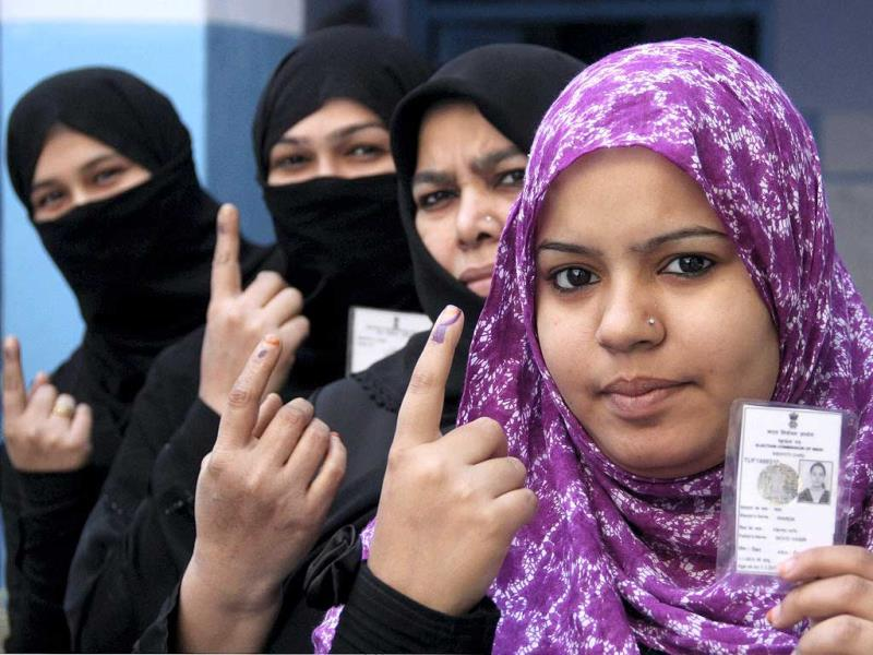 Muslim women voters at a polling station near Jama Masjid during Delhi Assembly polls in Old Delhi on Wednesday. (PTI photo)