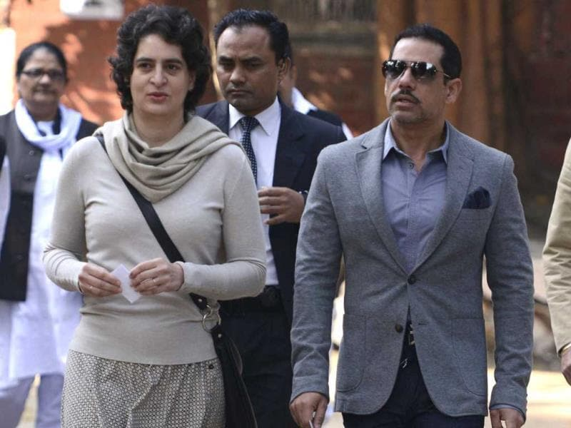 Priyanka Gandhi and husband Robert Vadra arrive at a polling station to cast their votes for the Delhi state assembly election in New Delhi. (AFP photo)
