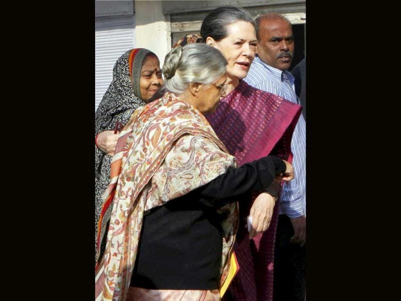 UPA chairperson Sonia Gandhi and Delhi chief minister Sheila Dikshit arrive at Nirman Bhawan polling station in New Delhi to cast their votes for Delhi Assembly elections. (PTI photo)