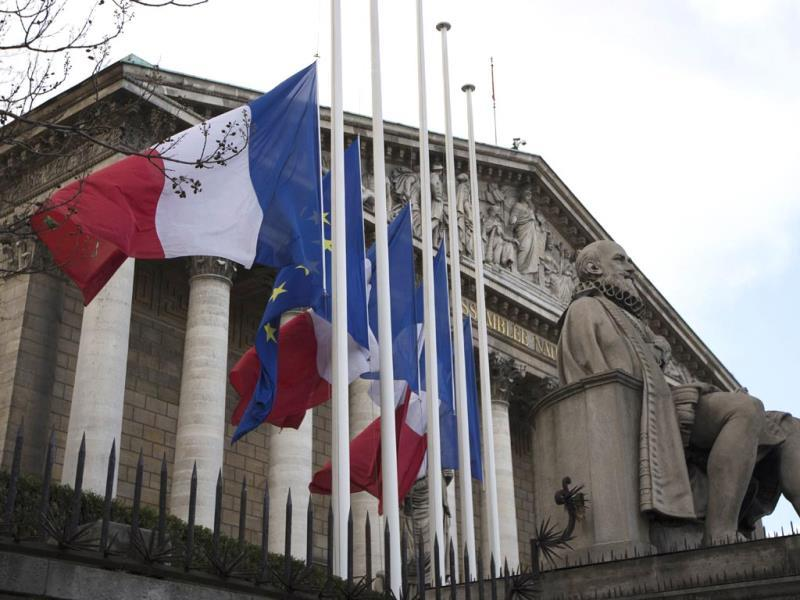 French flags and European flag fly half-mast in front of the French National Assembly in Paris, a day after the death in Johannesburg of South African former president Nelson Mandela. (AFP)