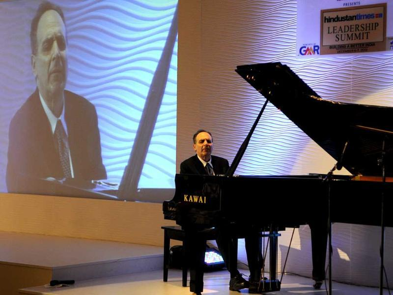 Dr Richard Kogan concert pianist and psychiatrist playing kawai piano during an interaction session on the second day of third session at the summit. (Gurpreet Singh/ HT Photo)