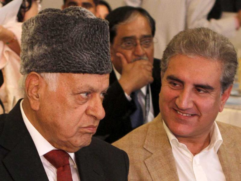 Ex-Jammu and Kashmir CM Farooq Abdullah seen with former Pakistan foreign minister Shah Mehmood Qureshi at the summit. (Virendra Singh Gosain/ HT Photo)