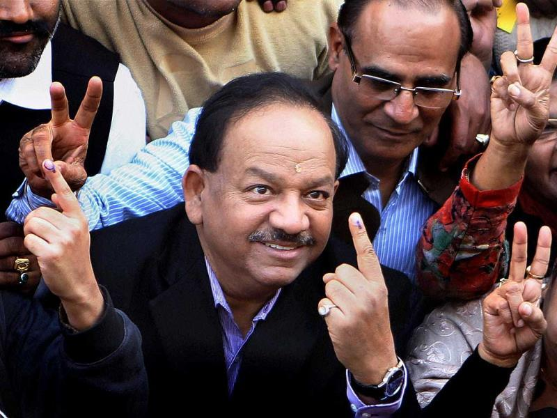 BJP's CM candidate Harsh Vardhan shows his ink-marked finger after casting his vote for Delhi Assembly elections at a polling station in East Delhi. (PTI)