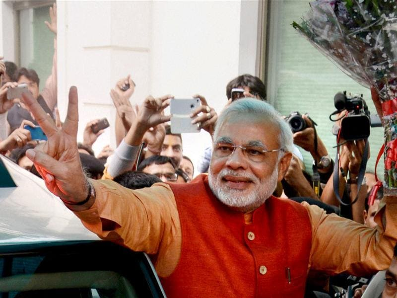 BJP's PM candidate Narendra Modi flashes a victory sign on arriving at the BJP HQ in New Delhi. (PTI)