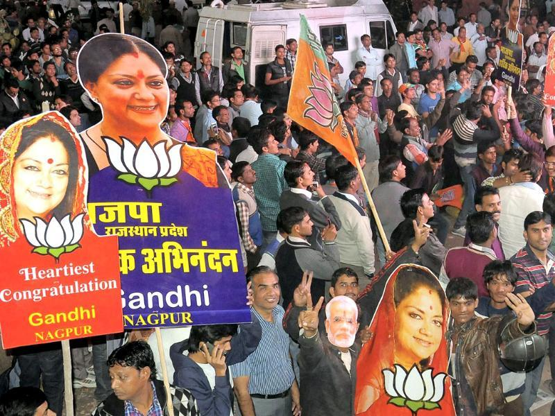 BJP workers celebrate their party's victory in the Rajasthan assembly elections in Jaipur. (PTI)