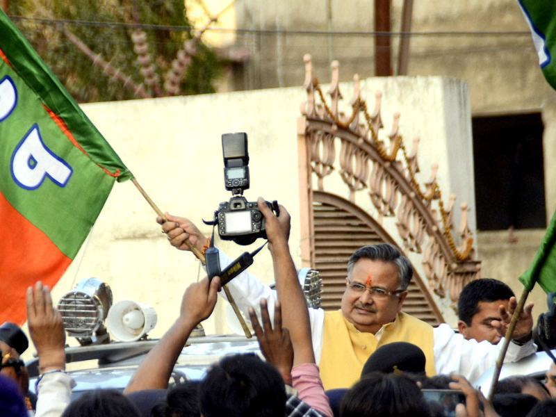 Chhattisgarh CM Raman Singh joins in party supporters after the BJP's win in the assembly elections in Raipur. (PTI)