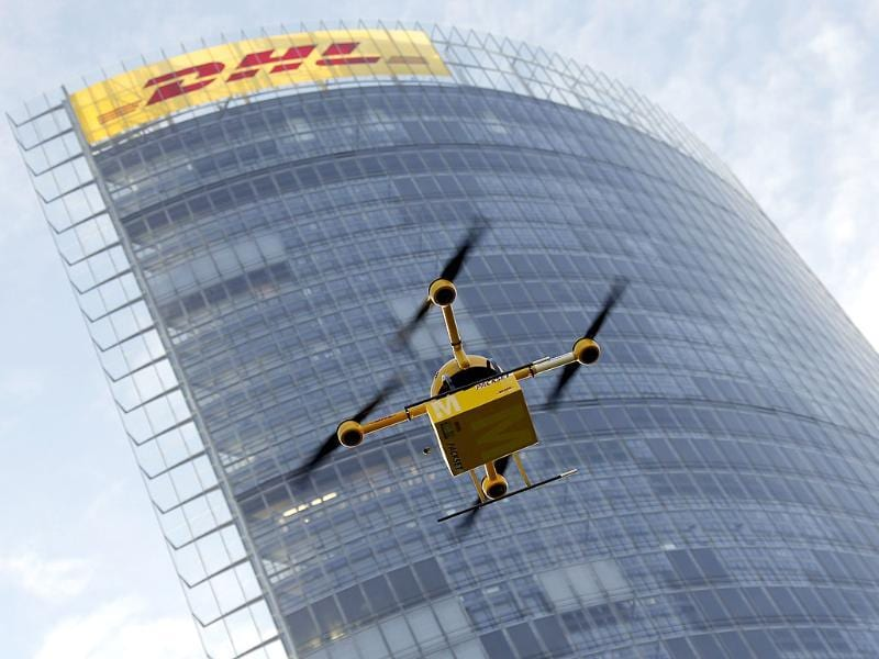 A quadrocopter drone controlled remotely transports a post package during a test flight for the Deutsche Post DHL in Bonn, western Germany on December. (AFP)