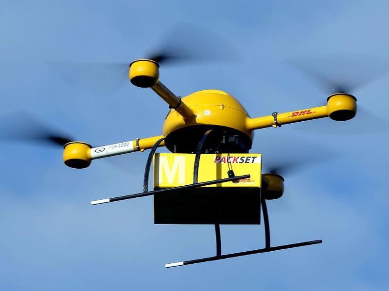 A drone with a small parcel flies in Bonn as Deutsche Post DHL tests a drone that could be used to deliver urgently needed goods to hard-to-reach places. (AP)