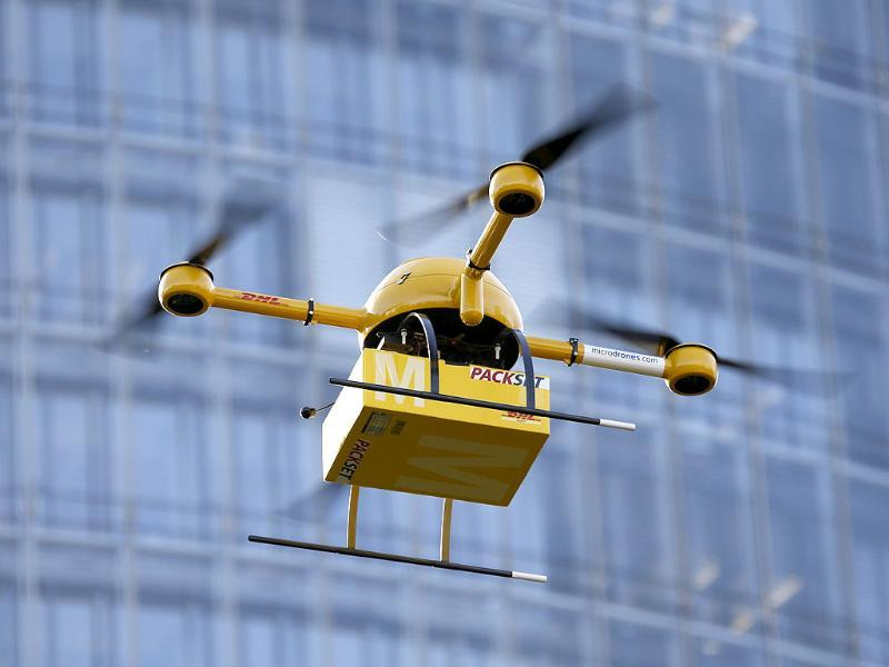 A prototype 'parcelcopter' of German postal and logistics group Deutsche Post DHL flies in front of the company's headquarters in Bonn. (Reuters)