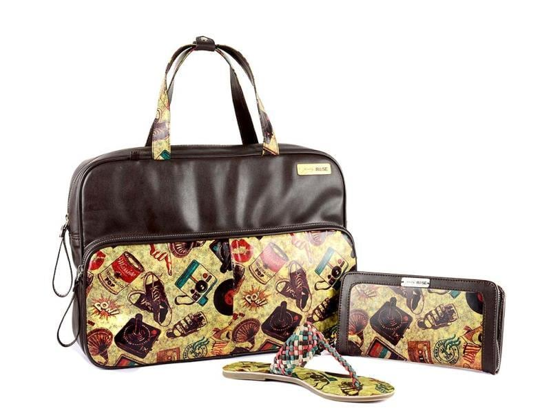 A funky leather laptop bag alongwith a clutch and matching footwear.
