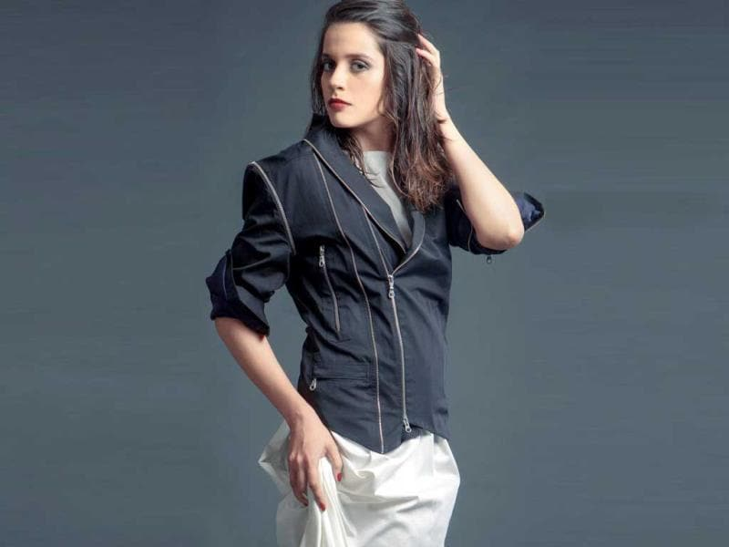 Fashion blogger Akanksha Redhu wears a white cotton sateen dress withe a black cotton biker jacket, made unique with it's multiple zips and edgy cuts.