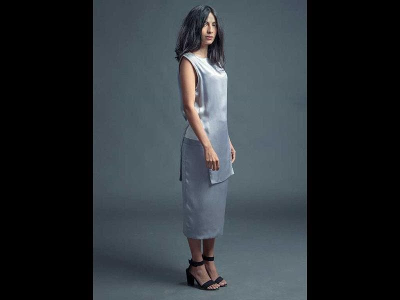 Stylist Meghna Bhalla, looks striking while wearing both a silver top and a white and silver skirt, the white portion only visible from the side.