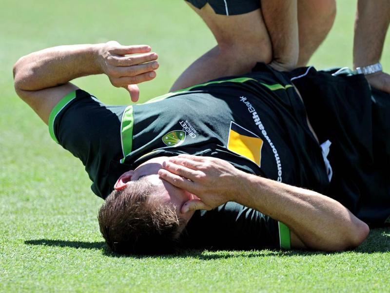 Australian cricketer Ryan Harris receives treatment during a bowling session in the nets on the eve of the third Ashes cricket Test between England and Australia in Perth. (AFP PHOTO)