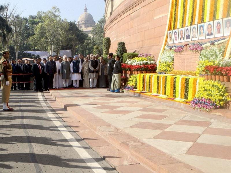 CRPF personnel and Parliamentarians during the tribute paying ceremony for the martyrs of Parliament attack on its 12th anniversary, at Parliament House. (PTI Photo)