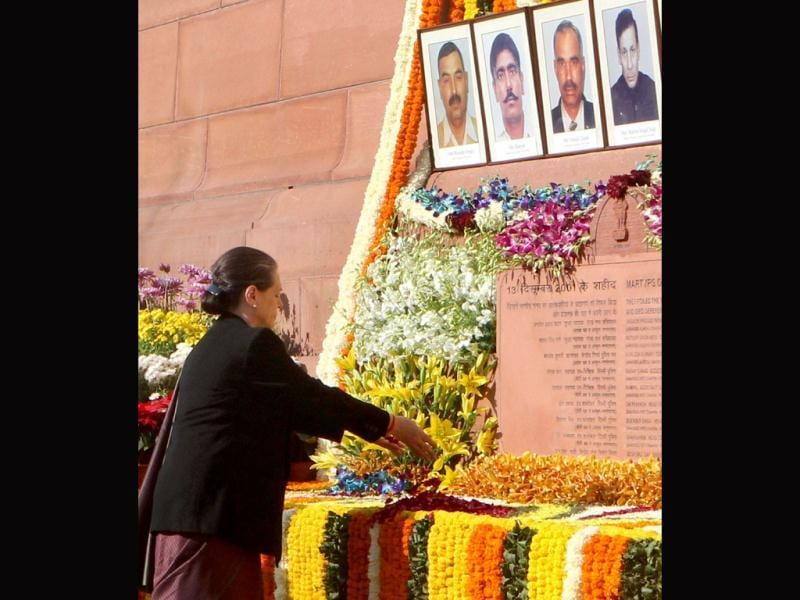 Congress president Sonia Gandhi pays floral tribute to the martyrs of December 13 Parliament attack on its 12th anniversary. (PTI Photo)
