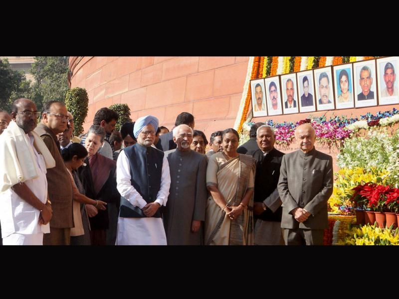 Prime Mnister Manmohan Singh, vice president Hamid Ansari and other dignitaries during the tribute paying ceremony for the martyrs of December 13 Parliament attack on its 12th anniversary. (PTI Photo)