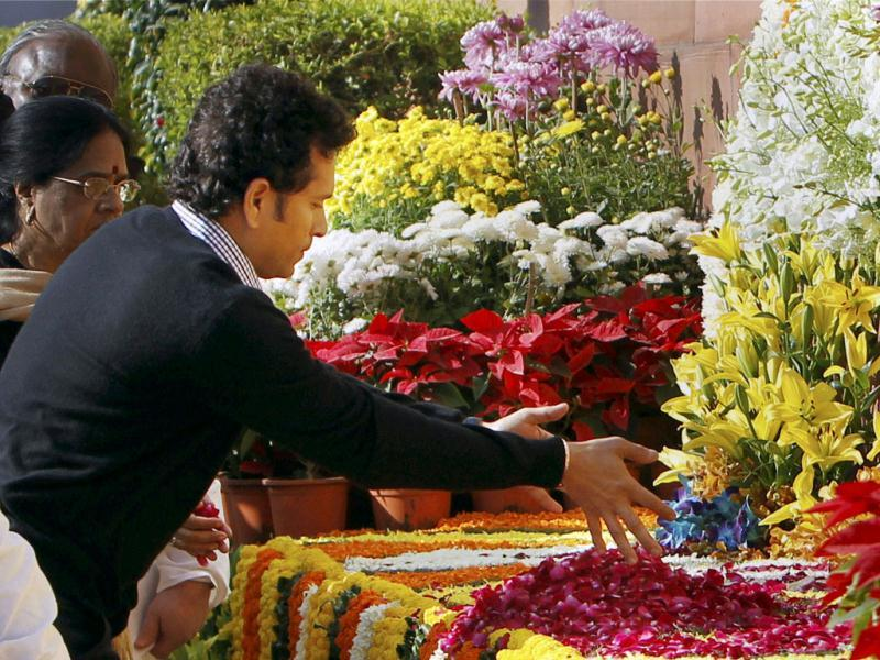 Rajya Sabha member Sachin Tendulkar pays floral tribute to the martyrs of December 13 Parliament attack on its 12th anniversary, at Parliament House. (PTI Photo)
