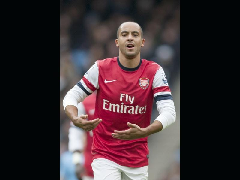 Arsenal's Theo Walcott gestures as he celebrates after scoring against Manchester City during their English Premier League soccer match at the Etihad Stadium. (AP Photo)