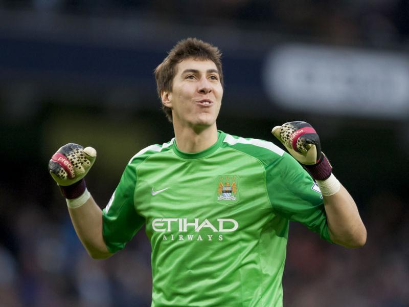 Manchester City's goalkeeper Costel Pantilimon celebrates his team's fifth goal against Arsenal during their English Premier League football match at the Etihad Stadium, Manchester. (AP Photo)