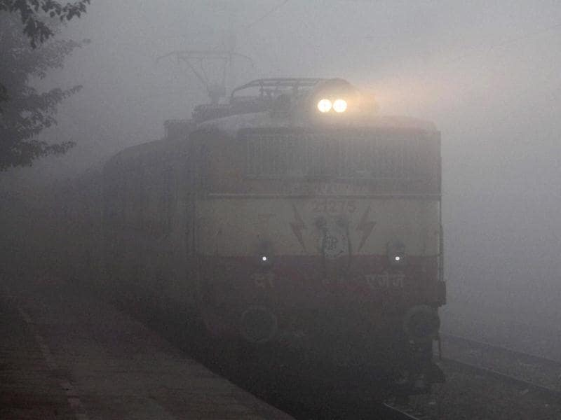 A train enveloped by thick fog in Faridabad. (PTI)