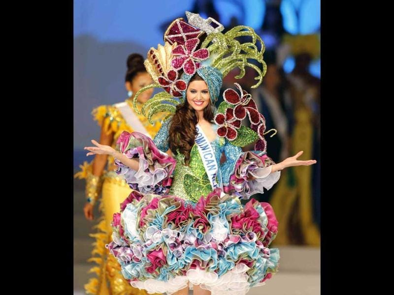 Miss Dominican Republic, Carmen Munoz, walks on stage during the national costume section of the 53rd Miss International Beauty Pageant in Tokyo. (Reuters)