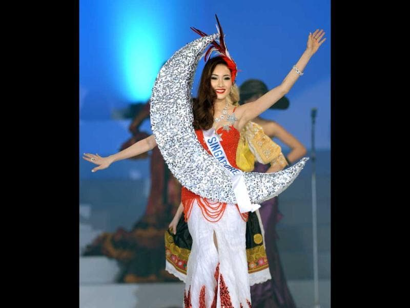 Clad in her national costume, Chew Jia Min of Singapore appears on stage during the 53rd Miss International Beauty Pageant in Tokyo. (AFP Photo)