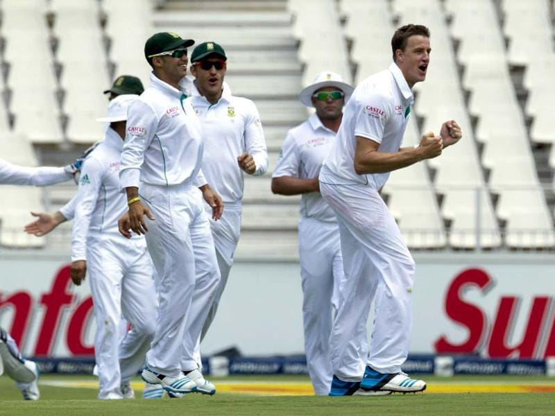 South Africa's Morne Morkel (R) celebrates with teammates after dismissing Murali Vijay for 8 runs during the first day of their Test at Wanderers stadium in Johannesburg. (AP Photo)