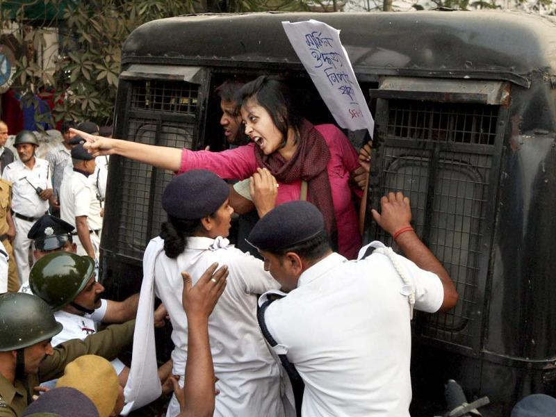 Police detain a student during their protest march to American Consulate against the alleged ill-treatment meted out to Indian diplomat Devyani Khobragade in the US. (PTI photo)