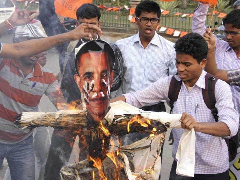 Activists of Akhil Bharatiya Vidyarthi Parishad, linked to the BJP, burn an effigy depicting US President Barack Obama during a protest in Bhubaneswar. (Reuters)