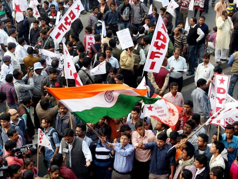 Students participate in a march to American consulate in Kolkata to protest against the alleged ill-treatment of India's deputy consul general in New York, Devyani Khobragade. (PTI)