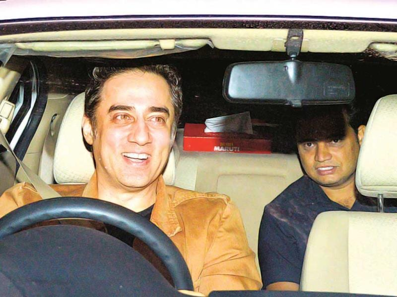 Aamir Khan's brother Faisal is all smiles as he arrives to attend Dhoom:3 screening.