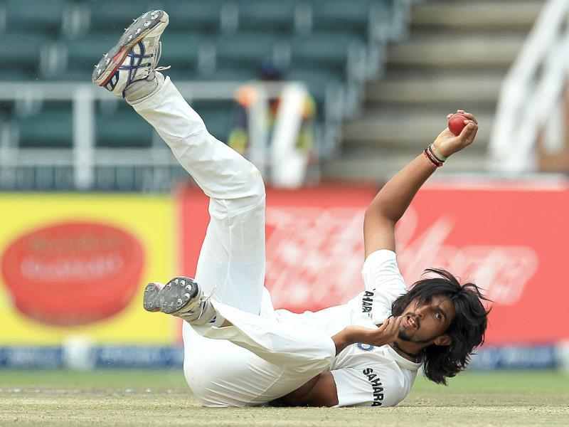 Ishant Sharma falls on the ground after fielding off his own bowling during the final day of the first Test against South Africa at the Wanderers Stadium. (AP Photo)