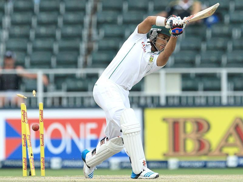 South Africa's JP Duminy is bowled for 5 runs during the final day of the first Test against India at the Wanderers Stadium in Johannesburg. (AP Photo)