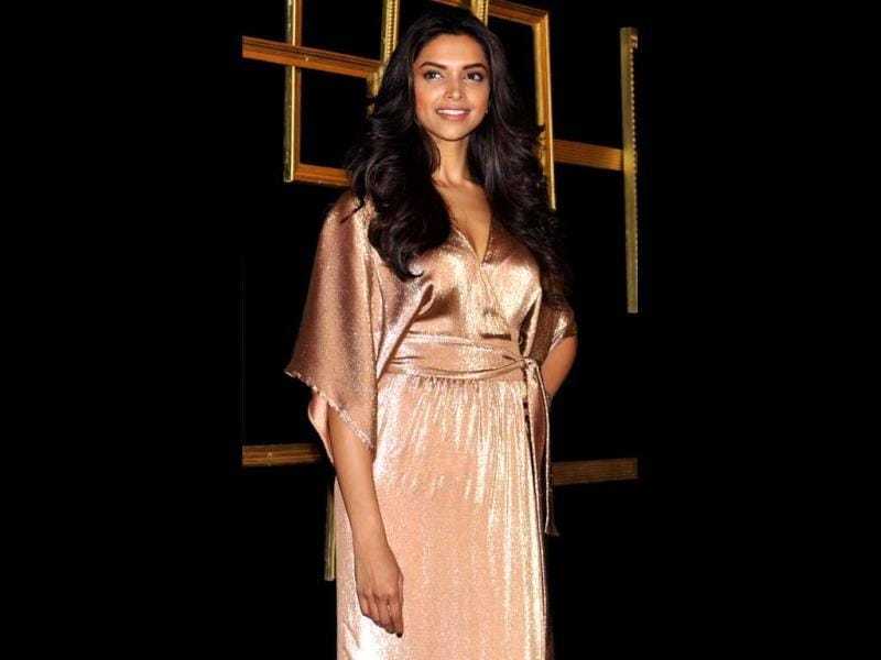 Sheen of success: Deepika Padukone is all smiles at her party.