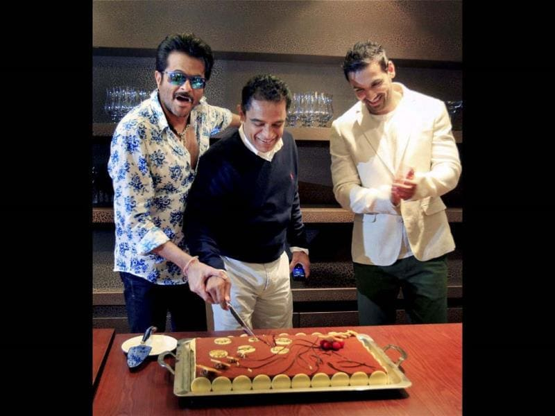 John Abraham and Anil Kapoor celebrate the birthday of with producer of their Welcome Back Firoz Nadiadwala at a hotel in Dubai. (PTI Photo)