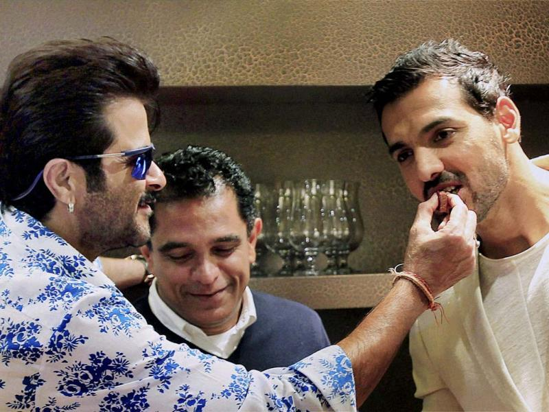 Bollywood actors John Abraham, Anil Kapoor and producer Firoz Nadiadwala, celebrated birthdays on sets of Welcome Back in Dubai recently. Take a look.(PTI Photo)