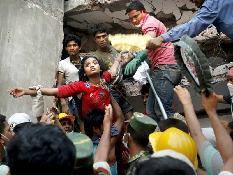 A Bangladeshi woman survivor is rescued at the site of Rana Plaza in Dhaka, Bangladesh that collapsed in April killing 1,129 people. (AP)