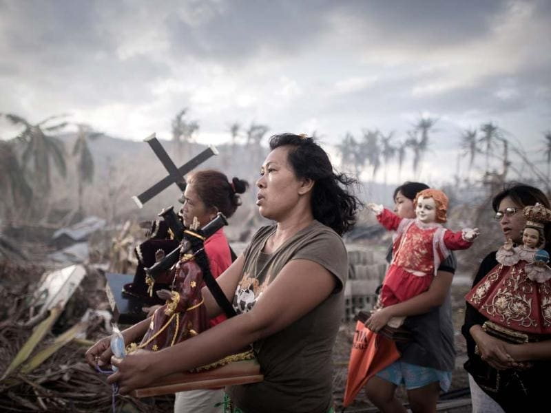 Survivors of super typhoon Haiyan march during a religious procession in Tolosa on the eastern Philippine island of Leyte in November, a week after Haiyan devastated the area, affecting an estimated 13 million people. (AFP)