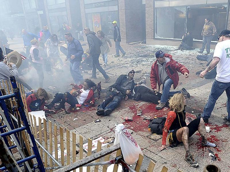 Injured people and debris lie on the sidewalk near the Boston Marathon finish line following an explosion in April. (AP)