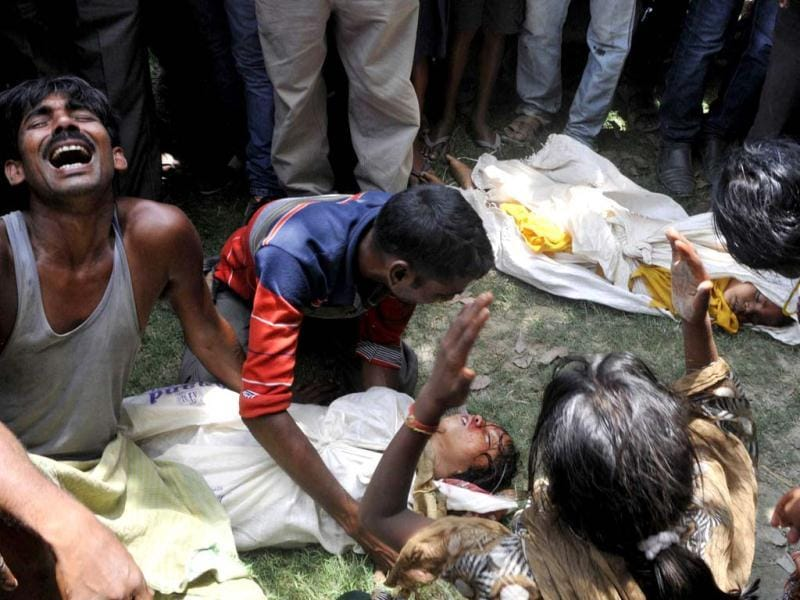 Grief-stricken family members react over the bodies of their children who died after consuming a free mid-day meal at a school in July in Saran district, Bihar. (HT Photo)