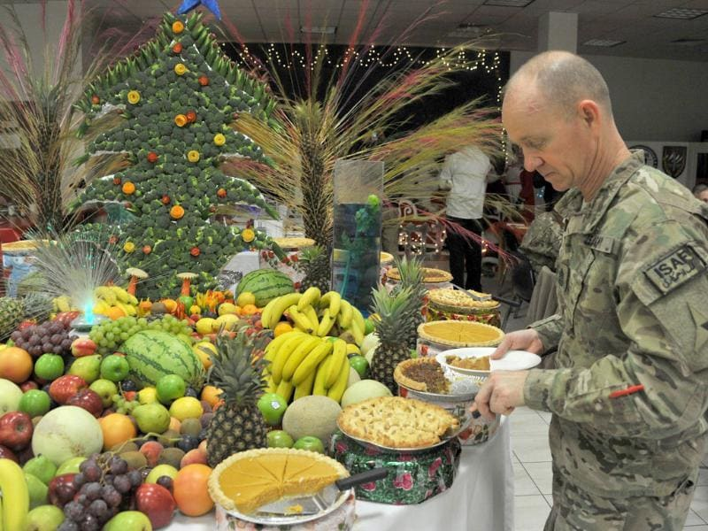 A soldier with the Nato-led International Security Assistance Force (ISAF) takes his food during a special meal on Christmas Day at a military base in Kabul. (AFP Photo)