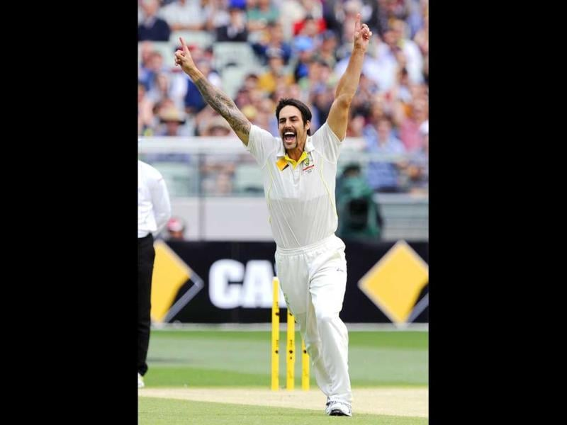 Australia's Mitchell Johnson celebrates the wicket of England's Tim Bresnan during the Fourth Ashes Test at the Melbourne Cricket Ground in Melbourne, Australia. (AP Photo)
