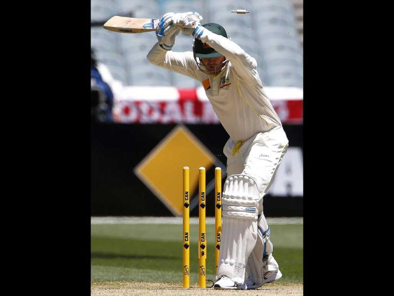 Australia's Michael Clarke is bowled out by England's James Anderson during the second day of the fourth Ashes Test at the Melbourne Cricket Ground. (Reuters Photo)