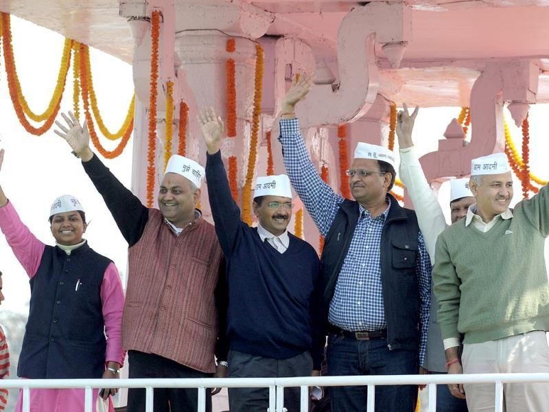 A file photo of Aam Aadmi Party convener and new chief minister of Delhi Arvind Kejriwal (2L) and his ministers wave after taking their oaths of office. (AFP Photo)