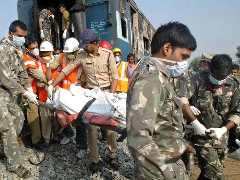 Rescue personnel carry away the remains of a passenger from the Nanded-Bangalore Express near Puttaparthi in Andhra Pradesh. (AFP)