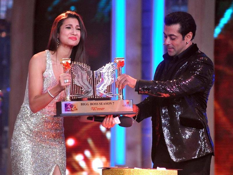 Gauhar Khan can't contain her happiness after Salman Khan hands over the trophy to her.