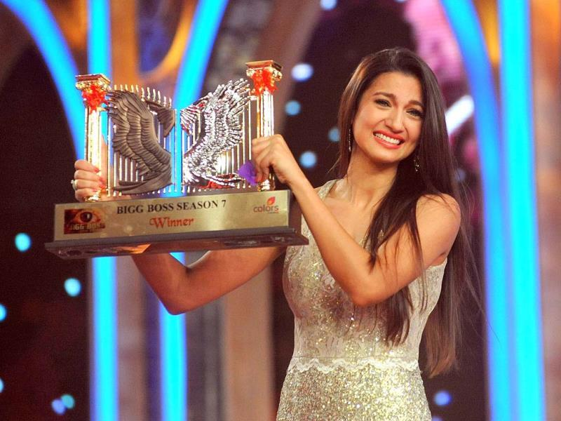 Gauhar Khan poses with her trophy.